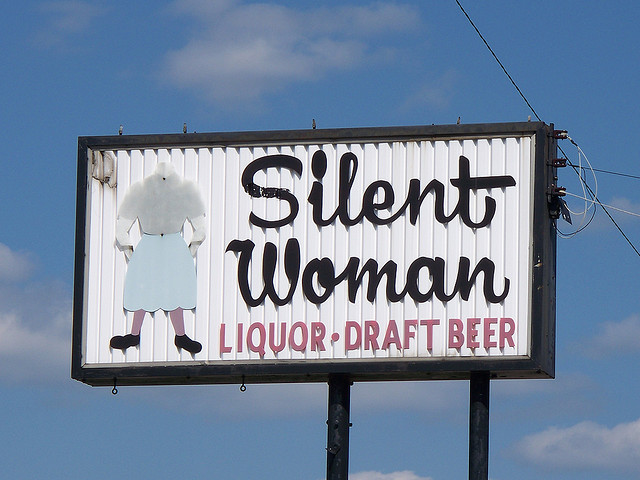 Sign for the Silent Woman Bar